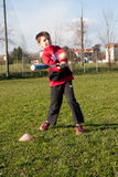 Child plays baseball. Child with red plush that plays baseball Stock Image