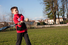 Child plays baseball. Child with red plush that plays baseball Stock Images