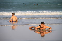 Child plays on the beach. PRANBURI, THAILAND - FEB 14: Unidentified Asia boy plays on the beach on Feb 14, 2014 in Khao Ka Lok, Pranburi, Thailand Royalty Free Stock Photography