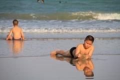 Child plays on the beach. PRANBURI, THAILAND - FEB 14: Unidentified Asia boy plays on the beach on Feb 14, 2014 in Khao Ka Lok, Pranburi, Thailand Royalty Free Stock Photo