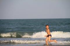 Child plays on the beach. PRANBURI, THAILAND - FEB 14: Unidentified Asia boy plays on the beach on Feb 14, 2014 in Khao Ka Lok, Pranburi, Thailand stock images