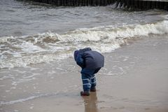 A child is playing in the beach Royalty Free Stock Images