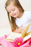 Child plays with book Stock Photo