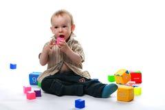 Сhild plays bricks Stock Photo