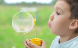 Child plays with bubbles Royalty Free Stock Image