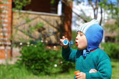 Child plays with bubbles Royalty Free Stock Photos