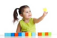 Child plays with building blocks and learning of colors Royalty Free Stock Photo