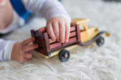 Child plays with car Royalty Free Stock Photography