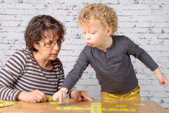 A child plays cards with his grandmother Royalty Free Stock Photo