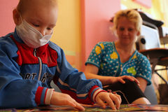 Child plays in children's playing room on hospital. Tomsk, Russia - June 25, 2009: Unidentified child plays in children's playing room in pediatric Royalty Free Stock Image