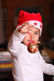 Child plays with Christmas decorations Stock Image