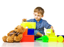 Child plays with color blocks Royalty Free Stock Photography