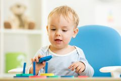 Child plays with colorful education toy Royalty Free Stock Image