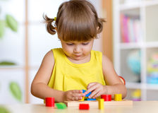 Child plays with colorful education toy Stock Photo