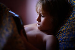 Child plays computer game on tablet Royalty Free Stock Photography
