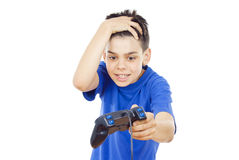 Child plays computer games Stock Images
