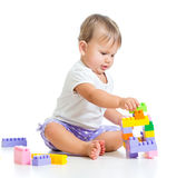 Child plays with construction set toys Stock Photo