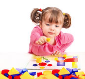 Child plays in developing games Royalty Free Stock Image