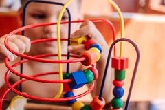 Child plays with developing toy stock photography