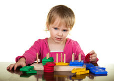 Child plays with education wooden toy Stock Photos
