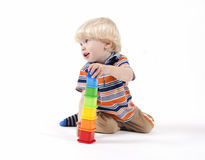 Child plays educational toy Royalty Free Stock Photo