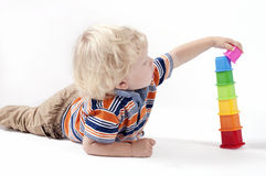 Child plays educational toy Stock Photography