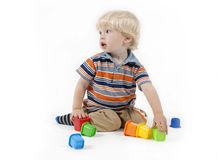 Child plays educational toy Royalty Free Stock Image