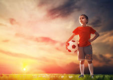 Child plays football Stock Images