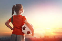 Child plays football. Royalty Free Stock Photography