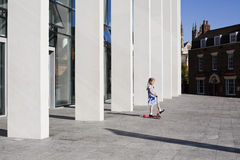 Child plays on forecourt of Marlowe Theatre Stock Photography
