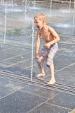 A child plays in a fountain Royalty Free Stock Images