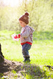 A child plays with a Frisbee outdoors. Stock Image