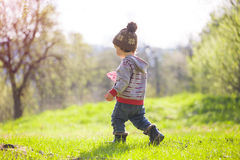 A child plays with a Frisbee outdoors. Royalty Free Stock Photos