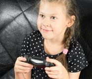 Child plays in a game Royalty Free Stock Image