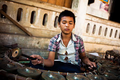 Child Plays Gamelan Instrument Stock Images