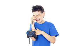 Child plays games on the joystick Stock Photos