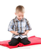 Child plays games on the mobile phone Royalty Free Stock Photo