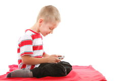 Child plays games on the mobile phone Stock Photo
