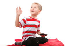 Child plays games on the mobile phone Royalty Free Stock Photos