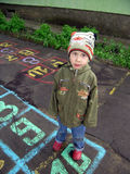 Child plays hopscotch game Royalty Free Stock Images