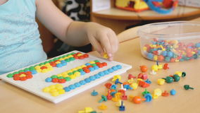 Child plays the intellectual educational game stock footage