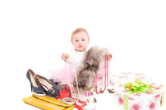 Child plays with jewelry Royalty Free Stock Image