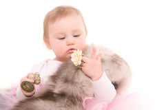 Child plays with jewelry adult Royalty Free Stock Photography