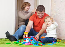 Child plays with meccano set in home Stock Image