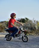 Child plays with minibikes. Stock Image