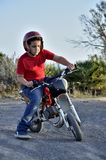 Child plays with minibikes. Stock Photography