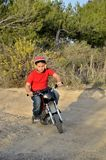Child plays with minibikes. Royalty Free Stock Photos