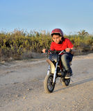 Child plays with minibikes. Stock Photo