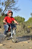 Child plays with minibikes. Royalty Free Stock Image