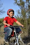 Child plays with minibikes. Royalty Free Stock Photography